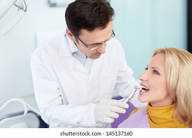 Doctor and patient in a dental clinic