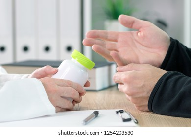 Doctor and patient discuss dietary supplement therapy in medical office during consultation