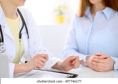Doctor and patient are discussing something, just hands at the table