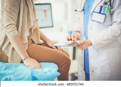 Doctor and patient discussing something while sitting at the table . Medicine and health care concept. Doctor and patient