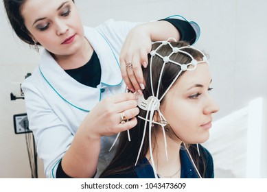 Doctor and patient with encephalography electrode. Electroencephalogram (EEG)