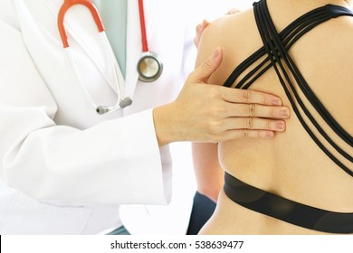 Doctor and patient, Examination of the shoulder and back, Sport exercise injuries. (Selective Focus)