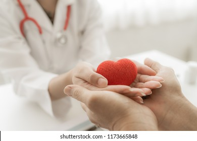 doctor and patient hands holding red heart, health care love, give, hope and family concept, world heart day,world health day