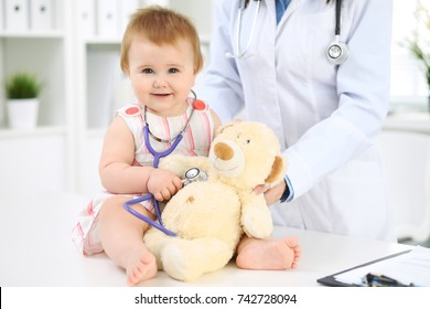 Doctor and patient. Happy cute baby  at health exam. Medicine and health care concept