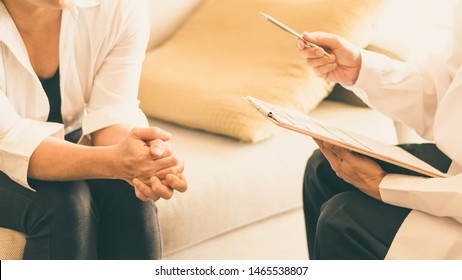 Doctor and patient healthcare concept. Gynecologist physician consulting and examining woman patient health in Obstetrics and Gynecology department in medical hospital health service center.