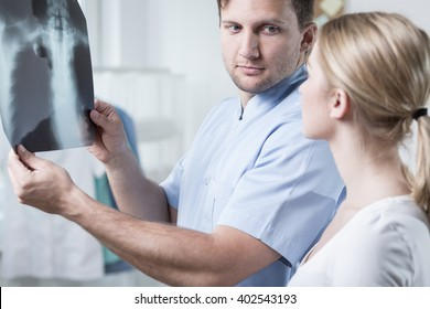 Doctor and patient looking at chest x-ray