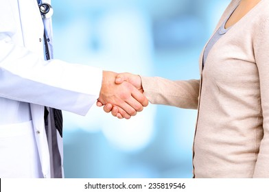 Doctor and patient, on hospital background