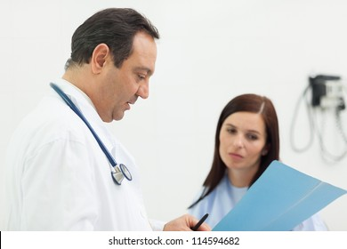 Doctor and a patient talking in an examination room