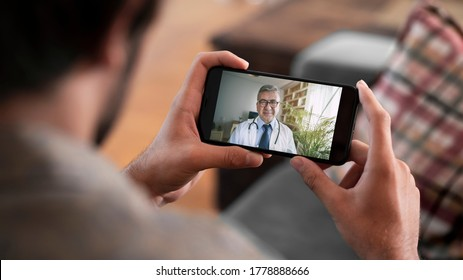 Doctor and patient talking on mobile phone