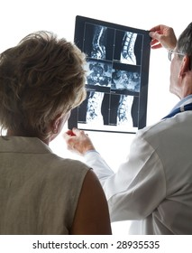 Doctor and Patient viewing X-Ray/MRI scans of her back and discussing her condition