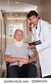 Doctor with patient wearing neck brace in wheelchair.