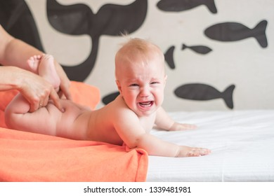 Doctor pediatric terapist a back and lumbar phisical massage to the newborn child for proper body shaping and body development. Baby back massage