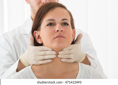 A Doctor Performing Physical Exam Palpation Of The Thyroid Gland