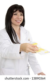 Doctor or pharmacist hands over a prescription and medicine with a friendly smile.