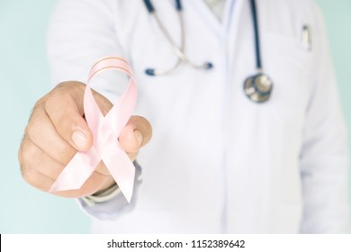 doctor with pink ribbon concept breast cancer and stethoscope.