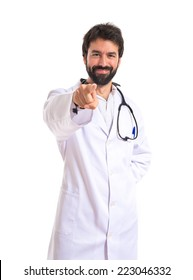 Doctor pointing to the front over white background