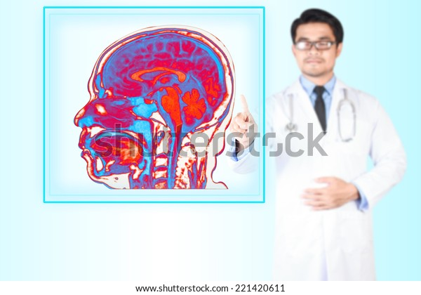 doctor pointing image magnetic resonance of human brain scan on virtual screen for diagnose