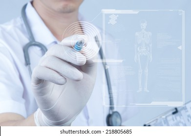 Doctor pointing pen toward digital screen about ebola