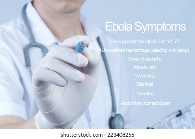 Doctor pointing pen to ward screen about Ebola Symptom
