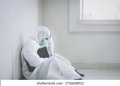 doctor in PPE suit uniform has stress in Coronavirus outbreak or Covid-19, Concept of Covid-19 quarantine.