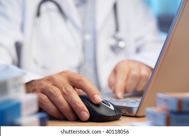 Doctor preparing online internet prescription selective focus