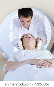 Doctor preparing the patient for MRI scan test