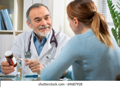 Doctor prescribes medicine to young patient during visit in the office