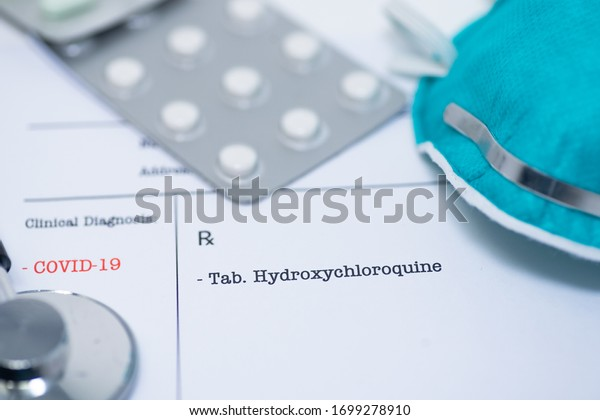 Doctor prescribing hydroxychloroquine for the treatment of novel coronavirus covid-19