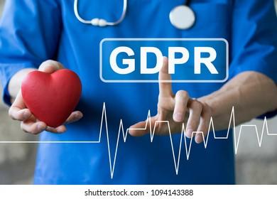 Doctor pressing button GDPR Data Protection Regulation heart pulse healthcare on virtual panel medicine