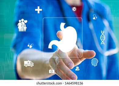 Doctor pressing button stomach health on virtual panel healthcare.
