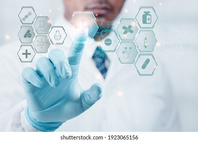 Doctor or a professional scientist Hand with anti-virus gloves points to the graphic, technology, mark, medical protection. The concept of antivirus protection with technology