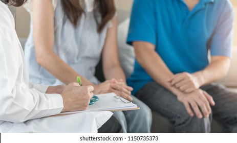 Doctor or psychologist with patient couple consulting on marriage counseling, family medical healthcare therapy, fertility treatment for infertility, or psychotherapy session concept