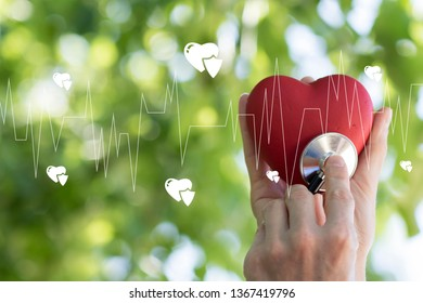 Doctor pushing button heart pulse healthcare in network on virtual web panel medicine.