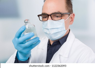 doctor reads label on a serum bottle