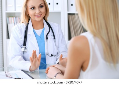 Doctor reassuring her female patient. Medicine, help and health care concept