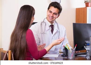 doctor receiving ill patient at office and questioning