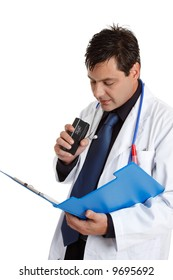 A doctor recording or dictating information from a patient medical consultation file or could be recording observations of treatment.