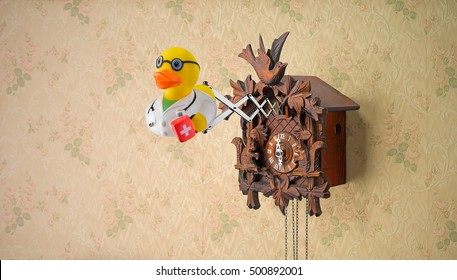Doctor rubber duck coming out of cuckoo clock on flowery wallpaper