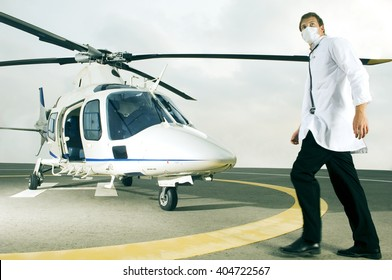 A doctor running towards a helicopter