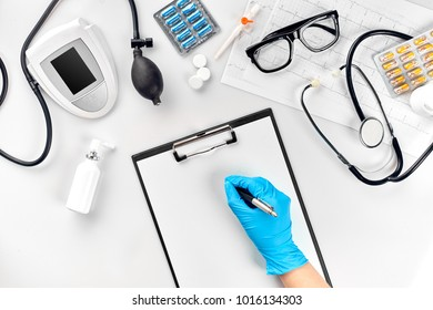 Doctor s table, tools, medical instruments, therapist tonometer, blood pressure, work in hospital on white background flat lay