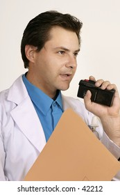 Doctor or scientist dictating