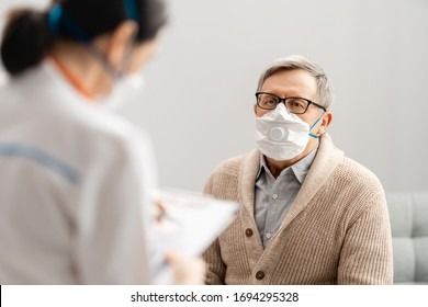 Doctor and senior man wearing facemasks during coronavirus and flu outbreak. Virus and illness protection, home quarantine. COVID-2019