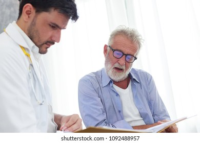 Doctor and senior patient discussing in health data. Healh care and medical concept consultation between doctor and patient