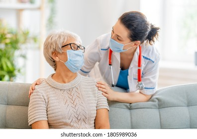 Doctor and senior woman wearing facemasks during coronavirus and flu outbreak. Virus protection. COVID-2019. Taking on masks.