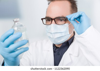 doctor with serum and reading glasses
