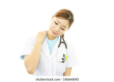Doctor with shoulder pain