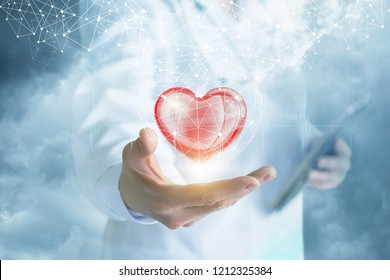 A doctor is showing a bright heart in the digital connections cage with a cloud of wireless connections above at the blurred background.