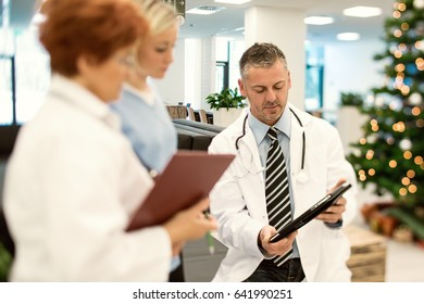doctor showing his new tablet computer