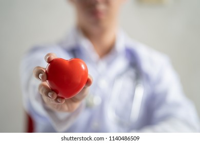 Doctor showing a red heart