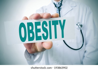 a doctor showing a signboard with the word obesity written in it